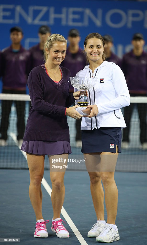 Klara Zakopalova of Czech and her partner <a gi-track='captionPersonalityLinkClicked' href=/galleries/search?phrase=Monica+Niculescu&family=editorial&specificpeople=2326066 ng-click='$event.stopPropagation()'>Monica Niculescu</a> of Romania pose with their Doubles champion trophy after winning the match against Lyudmyla Kichenok of Ukraine and her partner Nadiya Kichenok of Ukraine on day eight of the WTA Shenzhen Open at Shenzhen Longgang Sports Center on January 4, 2014 in Shenzhen, China.