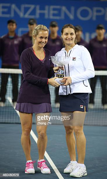 Klara Zakopalova of Czech and her partner Monica Niculescu of Romania pose with their Doubles champion trophy after winning the match against...