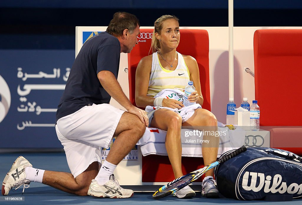 Klara Zakopalova of Czech Republic receives advice from her coach in her match against Marion Bartoli of France during day one of the WTA Dubai Duty Free Tennis Championship on February 18, 2013 in Dubai, United Arab Emirates.
