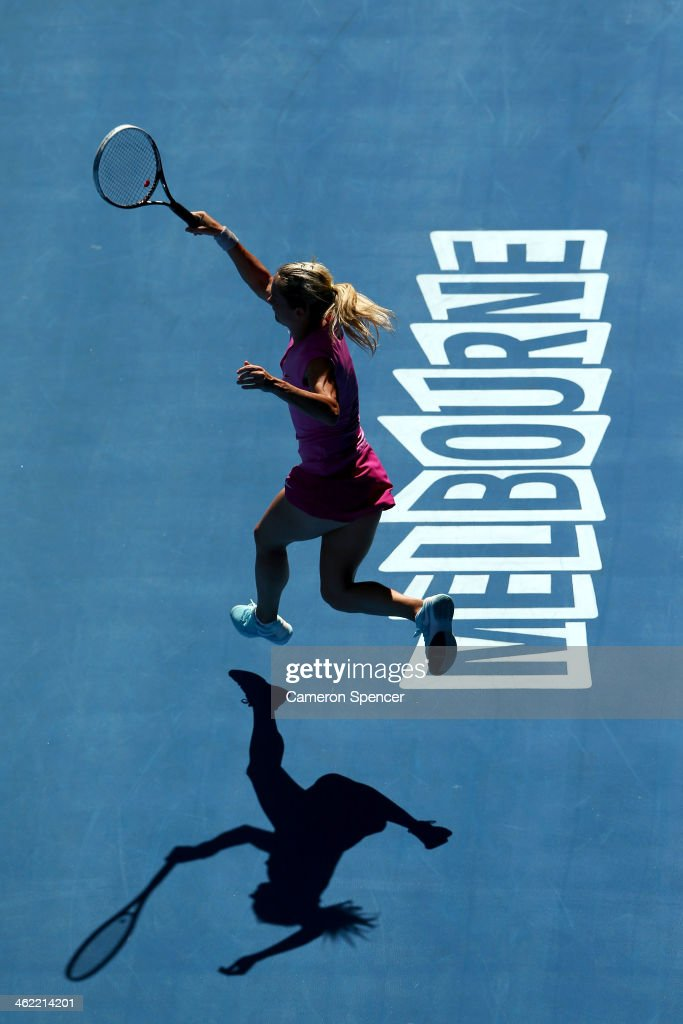 Klara Zakopalova of the Czech Republic plays a backhand in her first round match against Samantha Stosur of Australia during day one of the 2014 Australian Open at Melbourne Park on January 13, 2014 in Melbourne, Australia.
