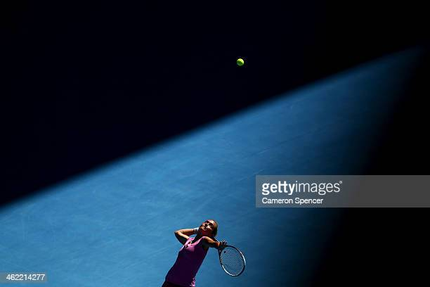 Klara Zakopalova of the Czech Republic serves in her first round match against Samantha Stosur of Australia during day one of the 2014 Australian...