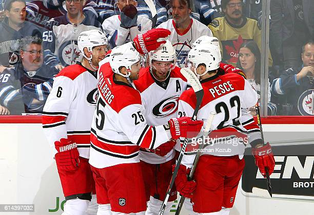 Klas Dahlbeck Viktor Stalberg Jordan Staal Brett Pesce and Bryan Bickell of the Carolina Hurricanes celebrate a second period goal against the...