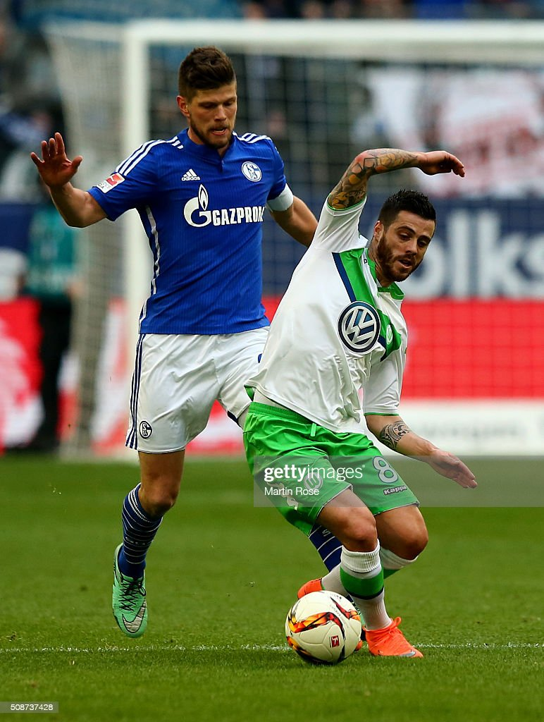 Klass Jan Huntelaar (L) of Schalke challenges <a gi-track='captionPersonalityLinkClicked' href=/galleries/search?phrase=Vieirinha&family=editorial&specificpeople=4320033 ng-click='$event.stopPropagation()'>Vieirinha</a> of Wolfsburg during the Bundesliga match between FC Schalke 04 and VfL Wolfsburg at Veltins-Arena on February 6, 2016 in Gelsenkirchen, Germany.