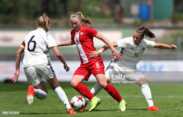 Klaudia Milek of Poland competes with Janina Minge and Tanja Pawollek of Germany during the U19 women's elite round match between Poland and Germany...