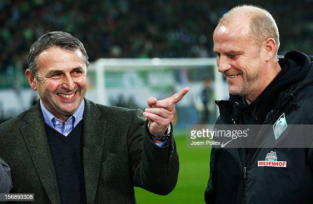 Klaus Allofs general manager sport of Wolfsburg and head coach Thomas Schaaf of Bremen chat prior to the Bundesliga match between VfL Wolfsburg and...
