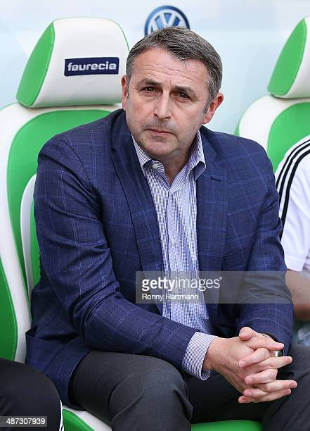 Klaus Allofs manager of Wolfsburg looks on prior to the Bundesliga match between VfL Wolfsburg and SC Freiburg at Volkswagen Arena on April 26 2014...