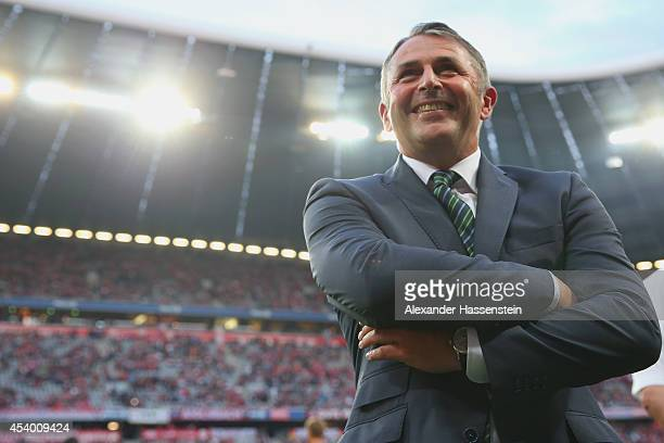 Klaus Allofs team manager of Wolfsburg looks on prior to the Bundesliga match between FC Bayern Muenchen and VfL Wolfsburg at Allianz Arena on August...