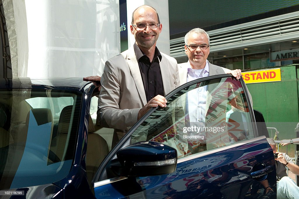 Klaus Bischoff, chief designer for Volkswagen AG, left, and Stefan Jacoby, president and chief executive officer of Volkswagen of America Inc., pose with the 2011 Jetta at its unveiling in New York, U.S., on Tuesday, June 15, 2010. Volkswagen AG plans to cut the U.S. price and increase the size of the Jetta compact car, its best-selling model in the country, as the automaker seeks to almost double sales in the market by 2012. Photographer: JB Reed/Bloomberg via Getty Images
