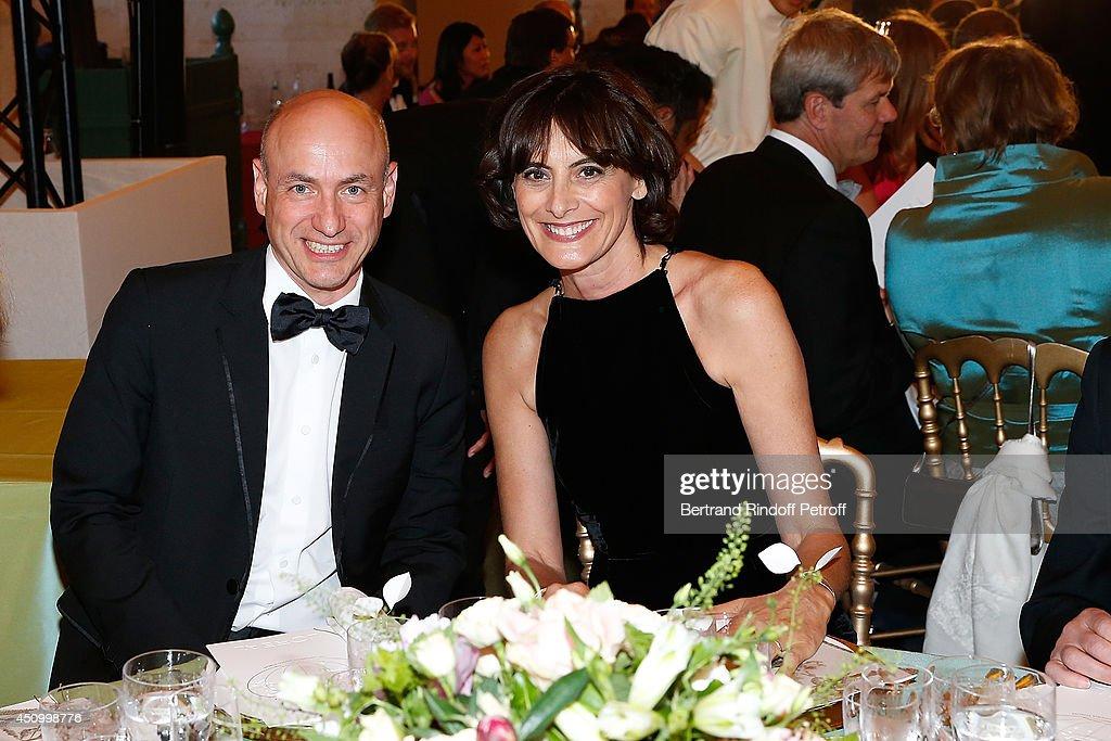 Klaus Dohle and Ines de la Fressange attend the L'Oreal Gala Evening 2014 at Chateau de Versailles on June 20, 2014 in Versailles, France.