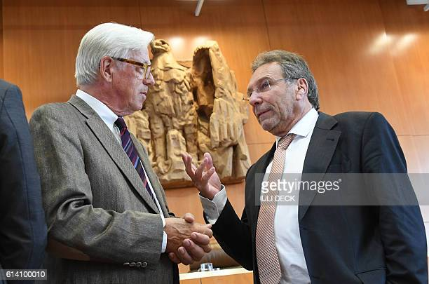 Klaus Ernst of the leftwing Die Linke party talks with appellant Thilo Bode chairman of Foodwatch as they wait for the opening of a hearing of an...