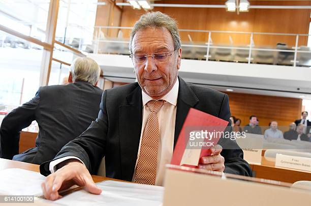 Klaus Ernst of the leftwing Die Linke party waits for the opening of a hearing of an emergency appeal against the transatlantic trade deal CETA at...