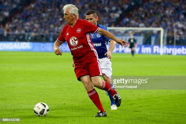 Klaus Fischer of Euro All Stars runs with the ball during the 20 years of Eurofighter match between Eurofighter and Friends and Euro All Stars at...