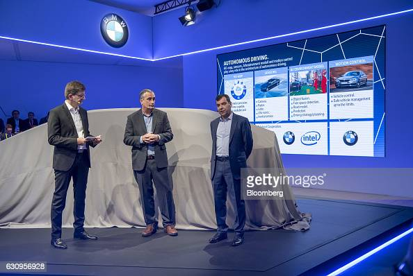 Klaus Froehlich member of the management board at Bayerische Motoren Werke AG from left and Brian Krzanich chief executive officer of Intel Corp...