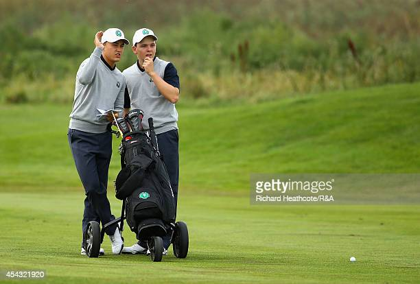 Klaus Ganter and Vince van Veen of Europe wait to plays into the 9th green in their match against Haydn McCullen and Jamie Dick of GBI during the...