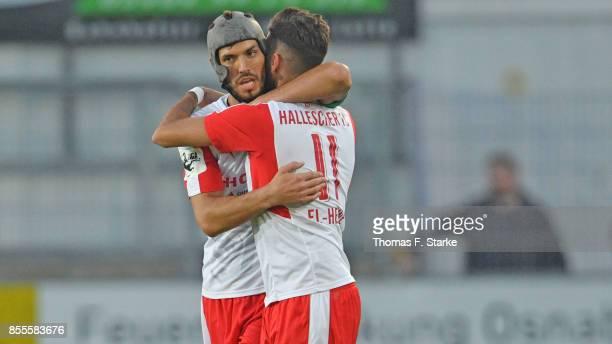 Klaus Gjasula and Hilal El Helwe of Halle celebrate during the 3 Liga match between Sportfreunde Lotte and Hallescher FC at Frimo Stadium on...