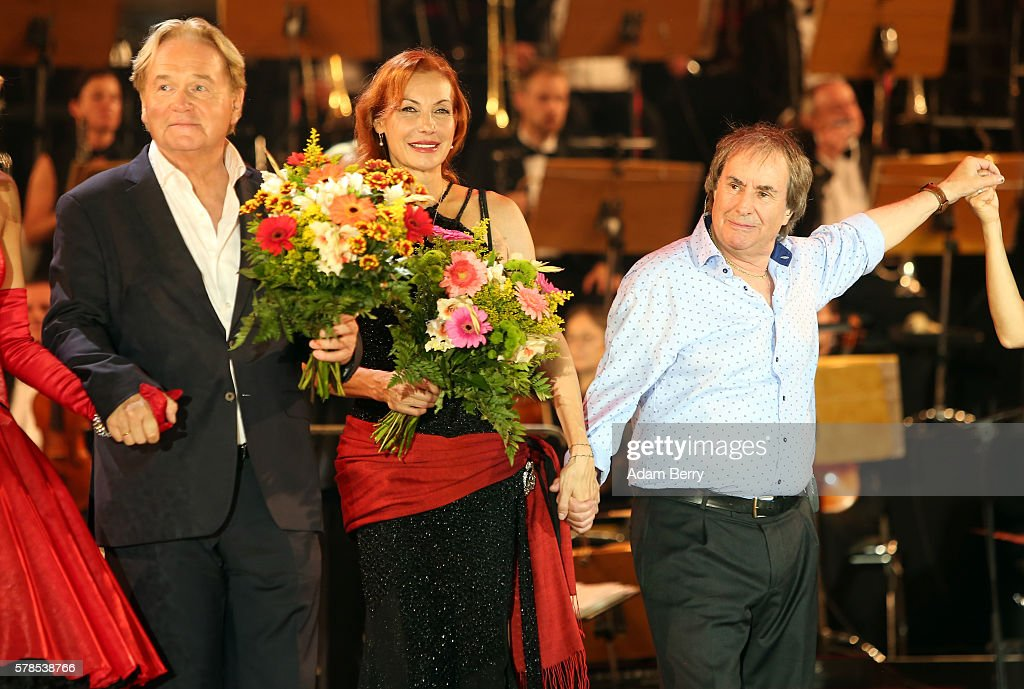 Klaus Hoffmann Ute Lemper and Chris de Burgh take a bow at the opening night of the Classic Open Air festival at Gendarmenmarkt on July 21 2016 in...