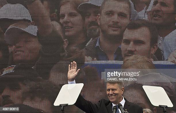 Klaus Iohannis candidate for presidency of Romania from the Christian Liberal Alliance waves to the public as he takes part in the launching of his...