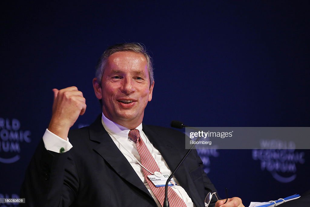 <a gi-track='captionPersonalityLinkClicked' href=/galleries/search?phrase=Klaus+Kleinfeld&family=editorial&specificpeople=558412 ng-click='$event.stopPropagation()'>Klaus Kleinfeld</a>, chairman and chief executive officer of Alcoa Inc., gestures as he speaks during the World Economic Forum Annual Meeting Of The New Champions in Dalian, China, on Wednesday, Sept. 11, 2013. The forum, also known as 'Summer Davos', runs from Sept. 11-13. Photographer: Tomohiro Ohsumi/Bloomberg via Getty Images