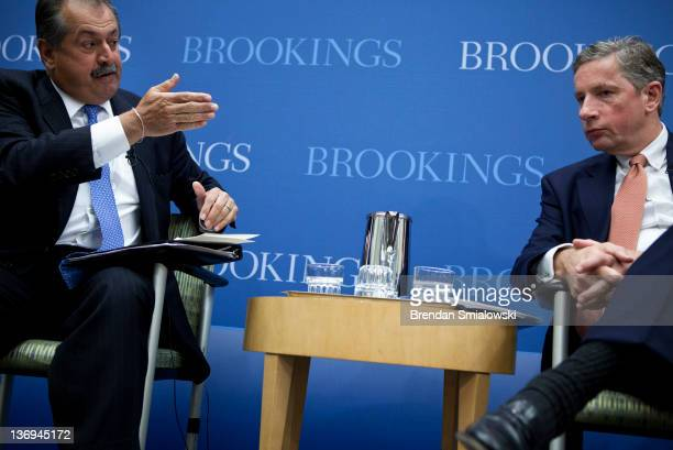 Klaus Kleinfeld Chairman and Chief Executive Officer of Alcoa listens as Andrew Liveris President Chairman and Chief Executive Officer of Dow...