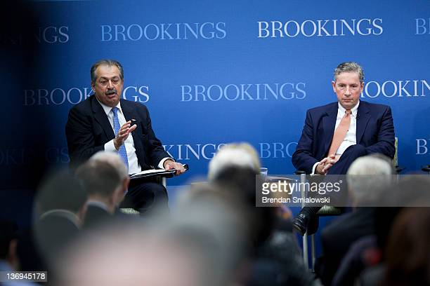 Klaus Kleinfeld Chairman and Chief Executive Officer of Alcoa listens while Andrew Liveris President Chairman and Chief Executive Officer of Dow...