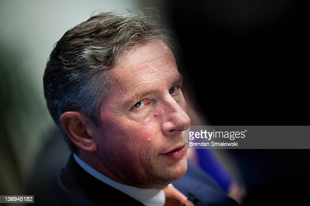 Klaus Kleinfeld Chairman and Chief Executive Officer of Alcoa listens during a panel discussion at the Brookings Institution January 13 2012 in...