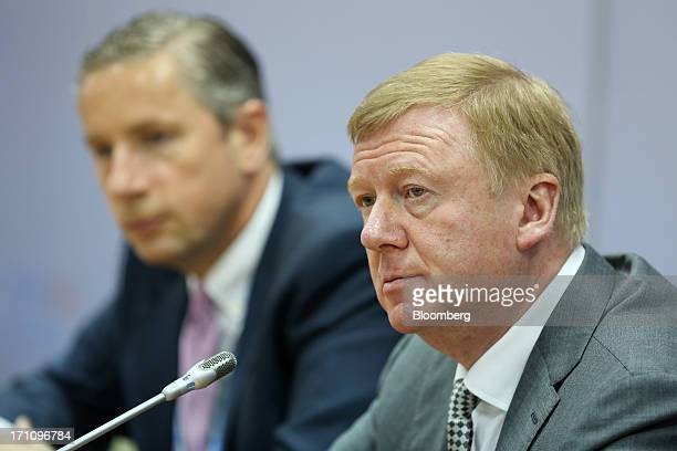 Klaus Kleinfeld chief executive officer of Alcoa Inc left and Anatoly Chubais chief executive officer of OAO Rusnano listen to questions during a...