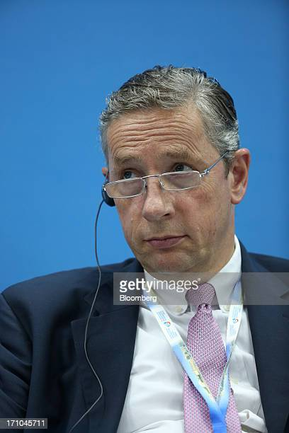 Klaus Kleinfeld chief executive officer of Alcoa Inc listens during a conference session on day two of the St Petersburg International Economic Forum...