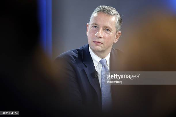 Klaus Kleinfeld chief executive officer of Alcoa Inc pauses during a session on day three of the World Economic Forum in Davos Switzerland on Friday...