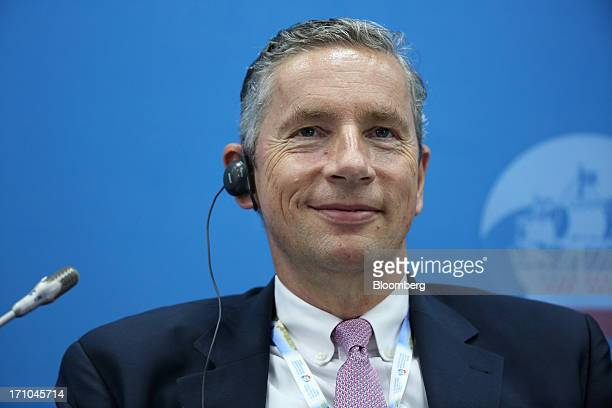 Klaus Kleinfeld chief executive officer of Alcoa Inc reacts during a conference session on day two of the St Petersburg International Economic Forum...