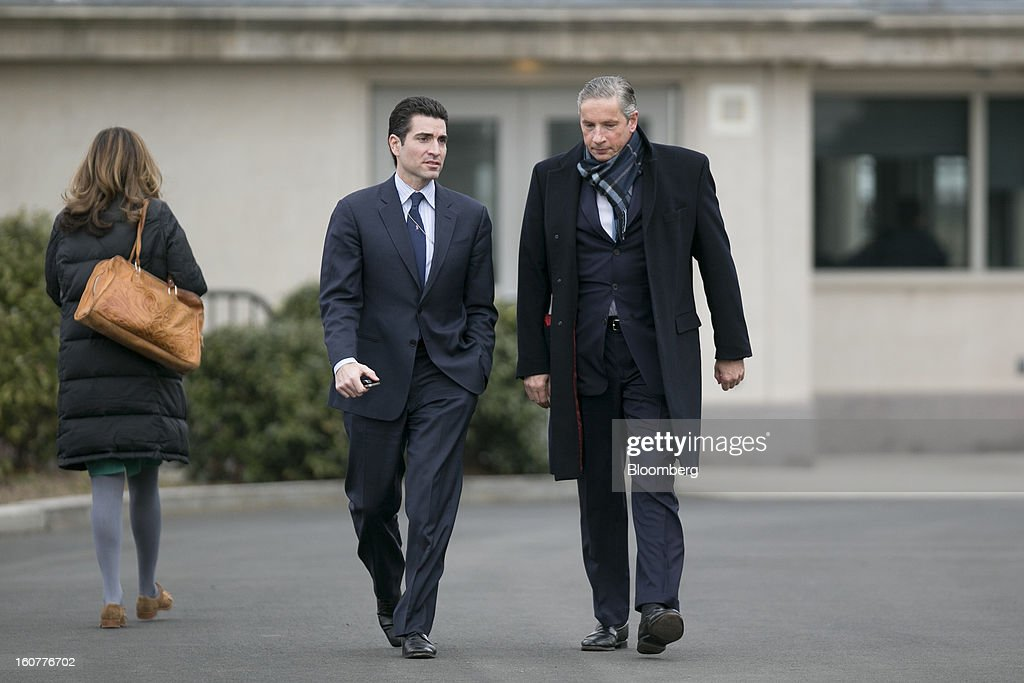 Klaus Kleinfeld, chief executive officer of Alcoa Inc, right, arrives to the White House to meet with U.S. President Barack Obama in Washington, D.C., U.S., on Tuesday, Feb. 5, 2013. U.S. Obama urged Congress to postpone automatic spending cuts scheduled to begin March 1 to avoid 'real and lasting impacts' on U.S. economic growth. Photographer: Andrew Harrer/Bloomberg via Getty Images