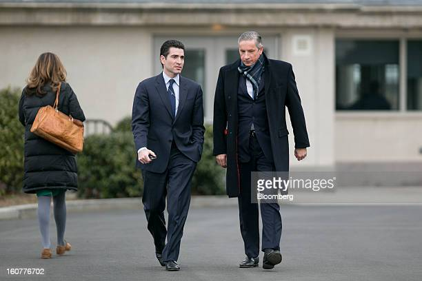 Klaus Kleinfeld chief executive officer of Alcoa Inc right arrives to the White House to meet with US President Barack Obama in Washington DC US on...