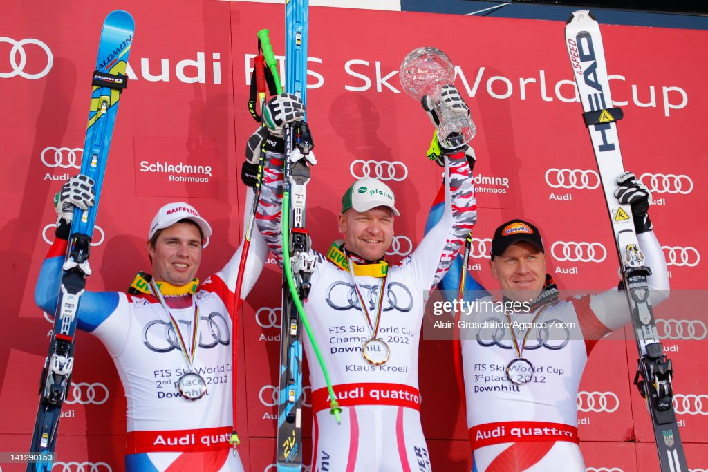 <a gi-track='captionPersonalityLinkClicked' href=/galleries/search?phrase=Klaus+Kroell&family=editorial&specificpeople=791783 ng-click='$event.stopPropagation()'>Klaus Kroell</a> of Austria takes the Overall Downhill World Cup globe, Beat Feuz of Switzerland takes 2nd place, <a gi-track='captionPersonalityLinkClicked' href=/galleries/search?phrase=Didier+Cuche&family=editorial&specificpeople=238957 ng-click='$event.stopPropagation()'>Didier Cuche</a> of Switzerland takes 3rd place during the Audi FIS Alpine Ski World Cup Men's Downhill on March 14, 2012 in Schladming, Austria.