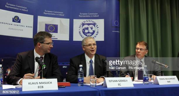 Klaus Masuch Istvan Szekely and Craig Beaumont speak to the media at a press conference on the progress of Irelands Fourth Quarter 2011 debt...