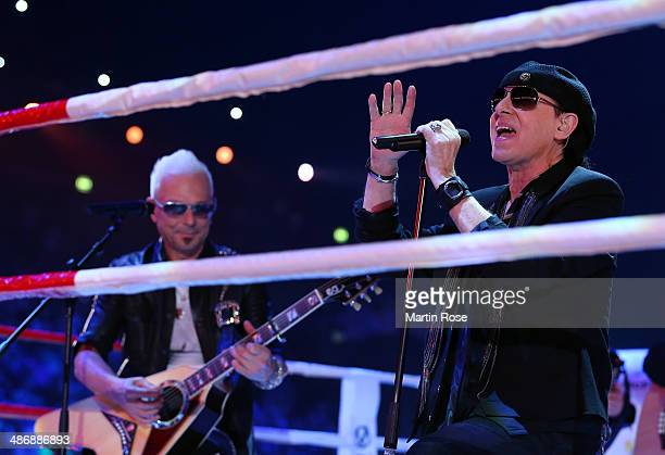 Klaus Meine of the Scorpions sings before the WBO WBA IBF and IBO heavy weight title fight between Wladimir Klitschkoat and Alex Lepai at...