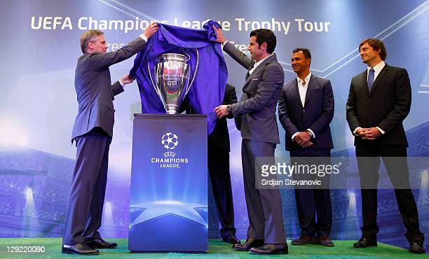 Klaus Priverschek chairman of Unicredit Bank Serbia and Luis Figo unveils the trophy during opening ceremony of the UEFA Champions League Trophy Tour...