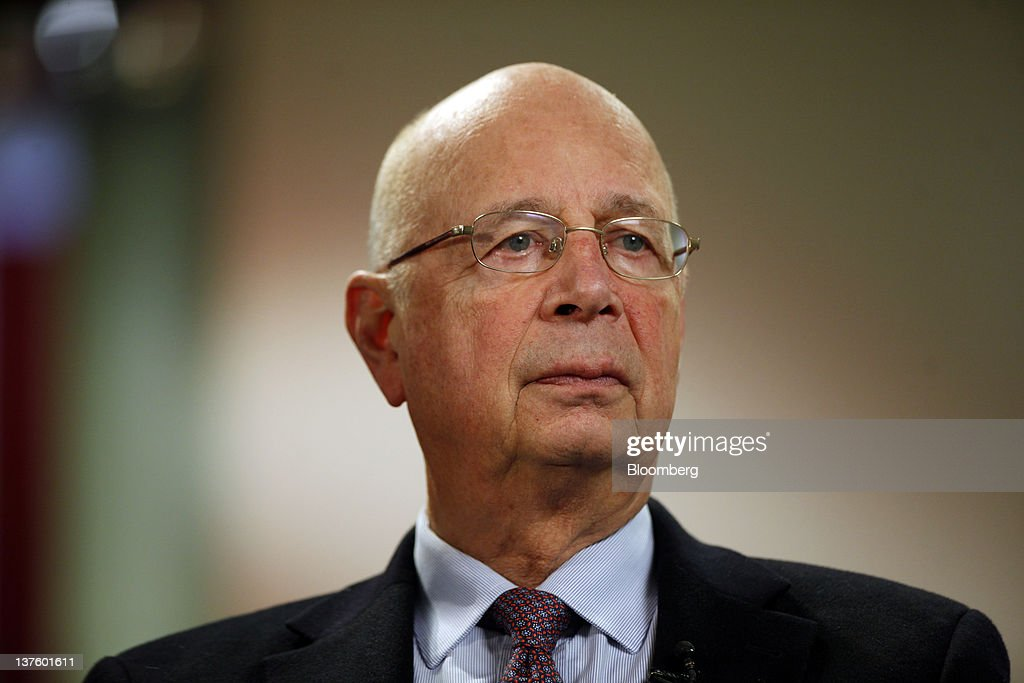 <a gi-track='captionPersonalityLinkClicked' href=/galleries/search?phrase=Klaus+Schwab&family=editorial&specificpeople=569943 ng-click='$event.stopPropagation()'>Klaus Schwab</a>, chairman of the World Economic Forum (WEF), pauses during a television interview in Davos, Switzerland, on Monday, Jan. 23, 2012. German Chancellor Angela Merkel will open this week's World Economic Forum in Davos, Switzerland, which will be attended by policy makers and business leaders including U.S. Treasury Secretary Timothy F. Geithner. Photographer: Simon Dawson/Bloomberg via Getty Images