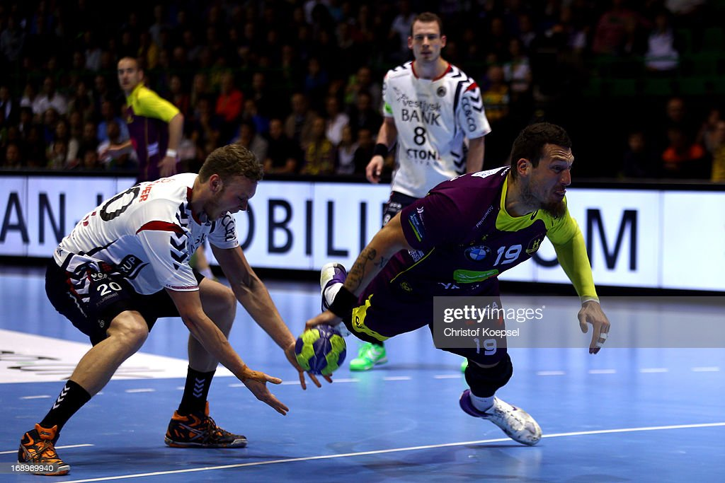 Klaus Thomsen of Holstebro treis to catch the ball against Borja-Vidal Fernandez of Nantes (R) during the EHF Cup Semi Final match between Tvis Holstebro and HBC Nantes at Palais des Sports de Beaulieu on May 18, 2013 in Nantes, France.