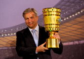 Klaus Wowereit mayor of Berlin holds the cup during the DFB cup handover at the city hall on April 21 2010 in Berlin Germany