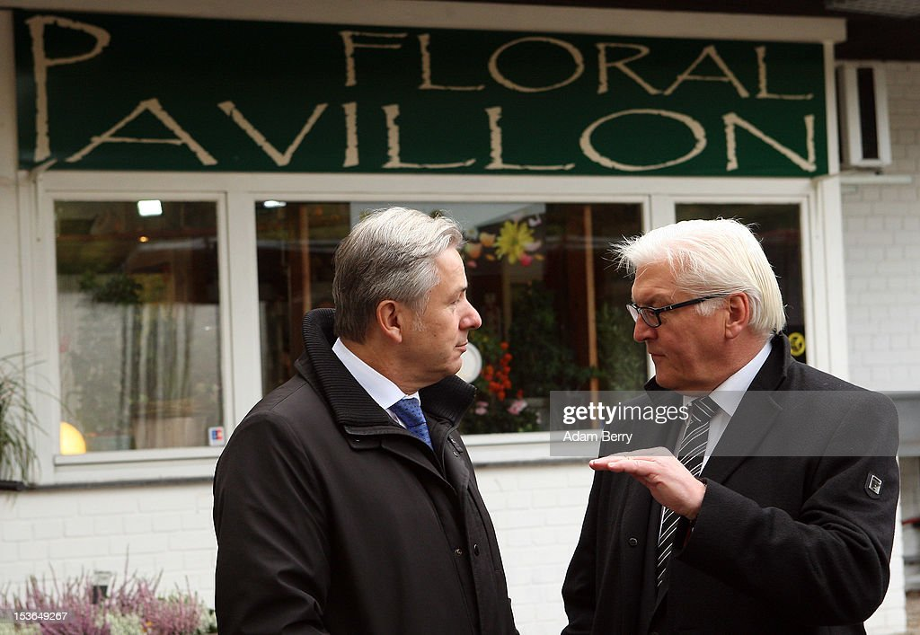 <a gi-track='captionPersonalityLinkClicked' href=/galleries/search?phrase=Klaus+Wowereit&family=editorial&specificpeople=213527 ng-click='$event.stopPropagation()'>Klaus Wowereit</a>, mayor of Berlin (L) speaks to <a gi-track='captionPersonalityLinkClicked' href=/galleries/search?phrase=Frank-Walter+Steinmeier&family=editorial&specificpeople=603500 ng-click='$event.stopPropagation()'>Frank-Walter Steinmeier</a>, the German Social Democrat party's Bundestag faction leader, as they arrive at a cemetery to visit the grave of Willy Brandt, former chancellor of the Federal Republic of Germany and Nobel Peace Prize winner, on October 8, 2012 in Berlin, Germany. Brandt was born on December 18, 1913 in Luebeck and died 20 years ago today. He led the SPD from 1964 to 1987 and was chancellor of West Germany from 1969 to 1974, a post from which he resigned after it was revealed that one of his closest aides worked as an agent of the East German secret service, or Stasi. For his efforts to achieve reconciliation between West Germany and the countries of the Soviet bloc, Brandt won the Nobel Prize for Peace in 1971.