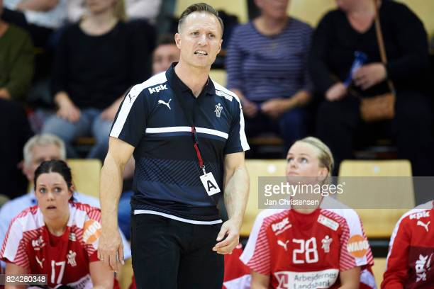 Klavs Bruun Jorgensen head coach of Denmark giving instructions from the bench during the international friendly match between Denmark and Germany at...