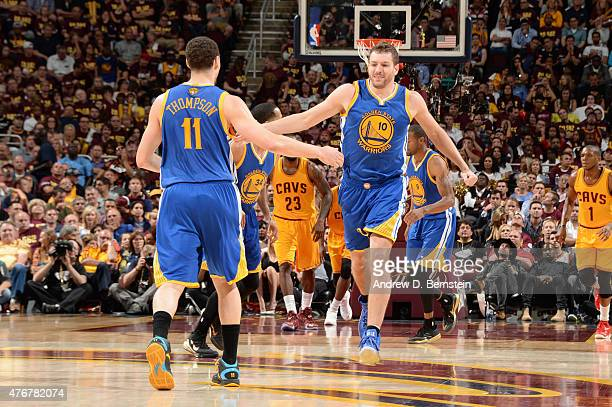 Klay Thompson and David Lee of the Golden State Warriors highfive during Game Four of the 2015 NBA Finals at The Quicken Loans Arena on June 11 2015...