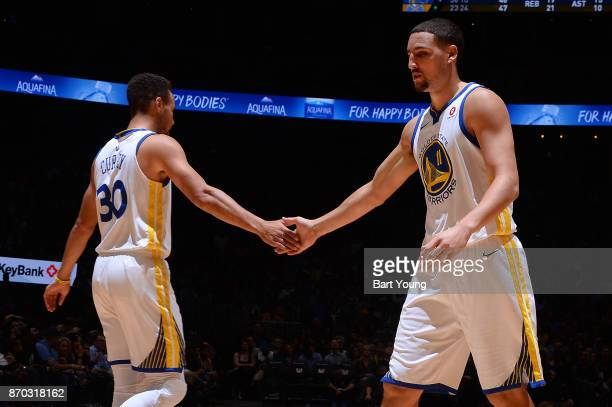 Klay Thompson and Stephen Curry of the Golden State Warriors high five during the game against the Denver Nuggets on November 4 2017 at the Pepsi...