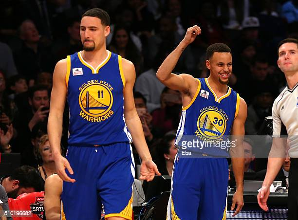 Klay Thompson and Stephen Curry of the Golden State Warriors react in the Foot Locker ThreePoint Contest during NBA AllStar Weekend 2016 at Air...