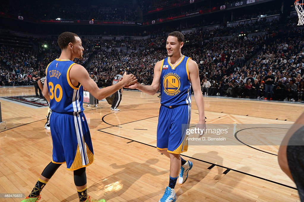 Klay Thompson and Stephen Curry of the Golden State Warriors shake hands during the Foot Locker Three Point Contest on State Farm AllStar Saturday...