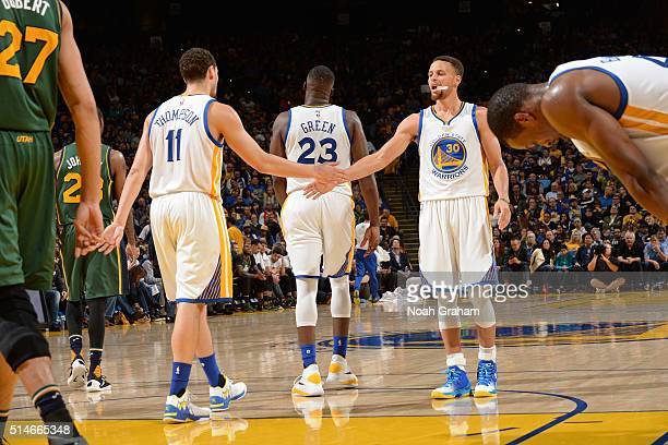 Klay Thompson and Stephen Curry of the Golden State Warriors shake hands during the game against the Utah Jazz on March 9 2016 at Oracle Arena in...