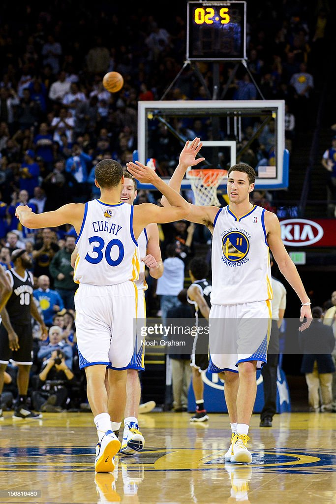 <a gi-track='captionPersonalityLinkClicked' href=/galleries/search?phrase=Klay+Thompson&family=editorial&specificpeople=5132325 ng-click='$event.stopPropagation()'>Klay Thompson</a> #11 and Stephen Curry #30 of the Golden State Warriors celebrate while playing the Brooklyn Nets at Oracle Arena on November 21, 2012 in Oakland, California.