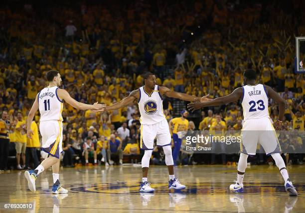 Klay Thompson Andre Iguodala and Draymond Green of the Golden State Warriors react against the Utah Jazz during Game One of the NBA Western...