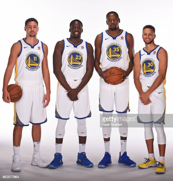 Klay Thompson Draymond Green Kevin Durant and Stephen Curry of the Golden State Warriors pose for a portrait during media day on September 22 2017 at...