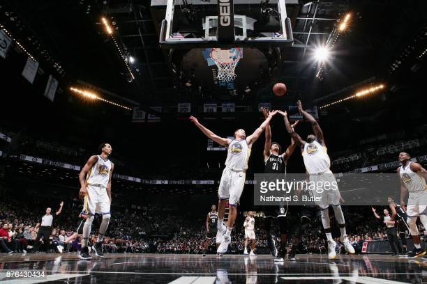 Klay Thompson Draymond Green of the Golden State Warriors and Jarrett Allen of the Brooklyn Nets jump for the rebound on November 19 2017 at Barclays...