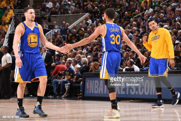 Klay Thompson high fives Stephen Curry of the Golden State Warriors against the Utah Jazz during Game Four of the Western Conference Semifinals of...